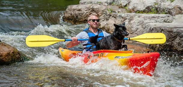 Kayaker and his dog enjoying the Argo Cascades